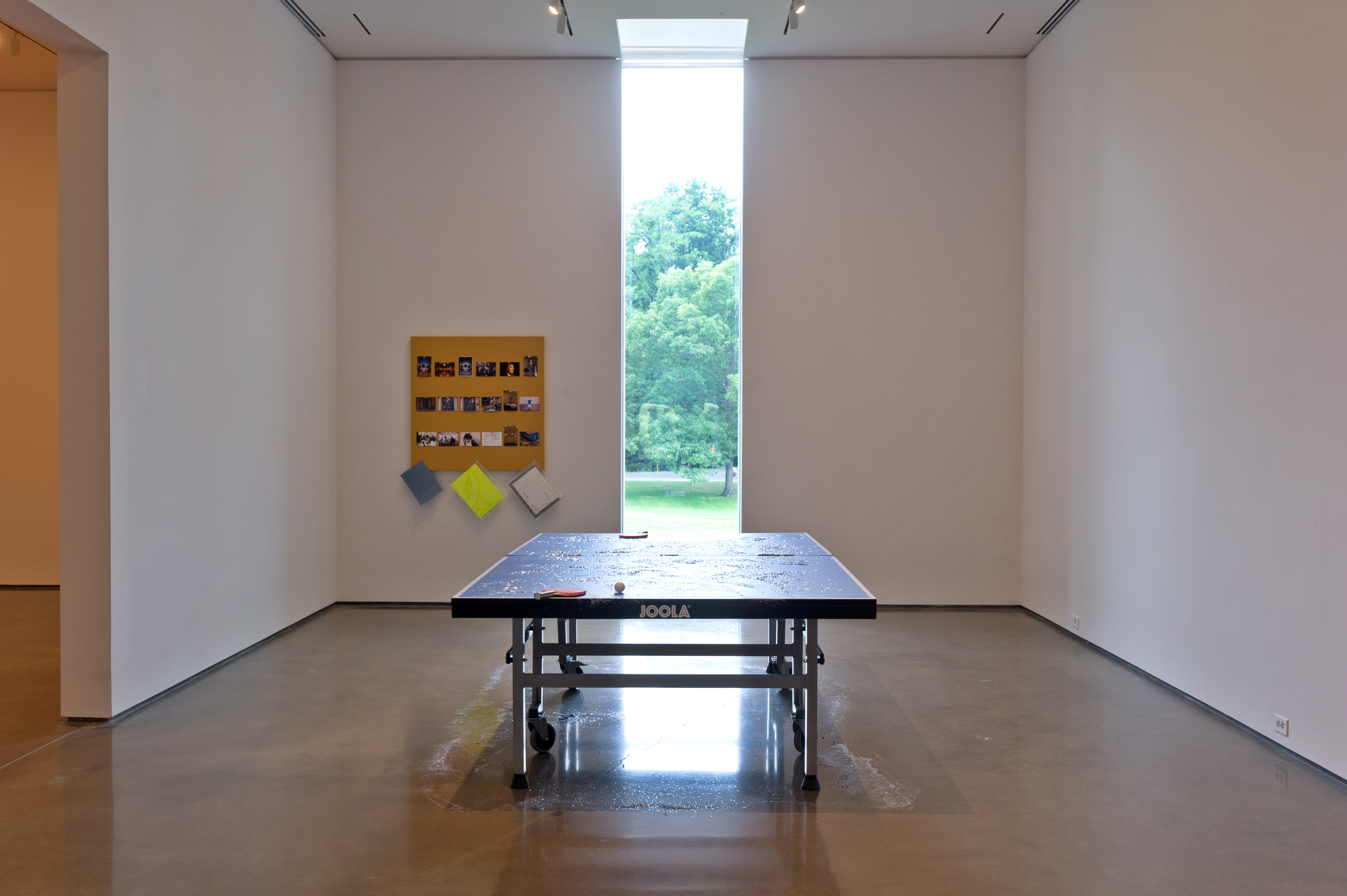 Liam Gillick, (The What if? Scenario) Dining Table, 1996 and The Pinboard Project, (Corn), 1992/2012. Realized by Vincenzo de Bellis. Installation view of From 199A to 199B : Liam Gillick, Hessel Museum of Art, 2012, Chris Kendall Photographer