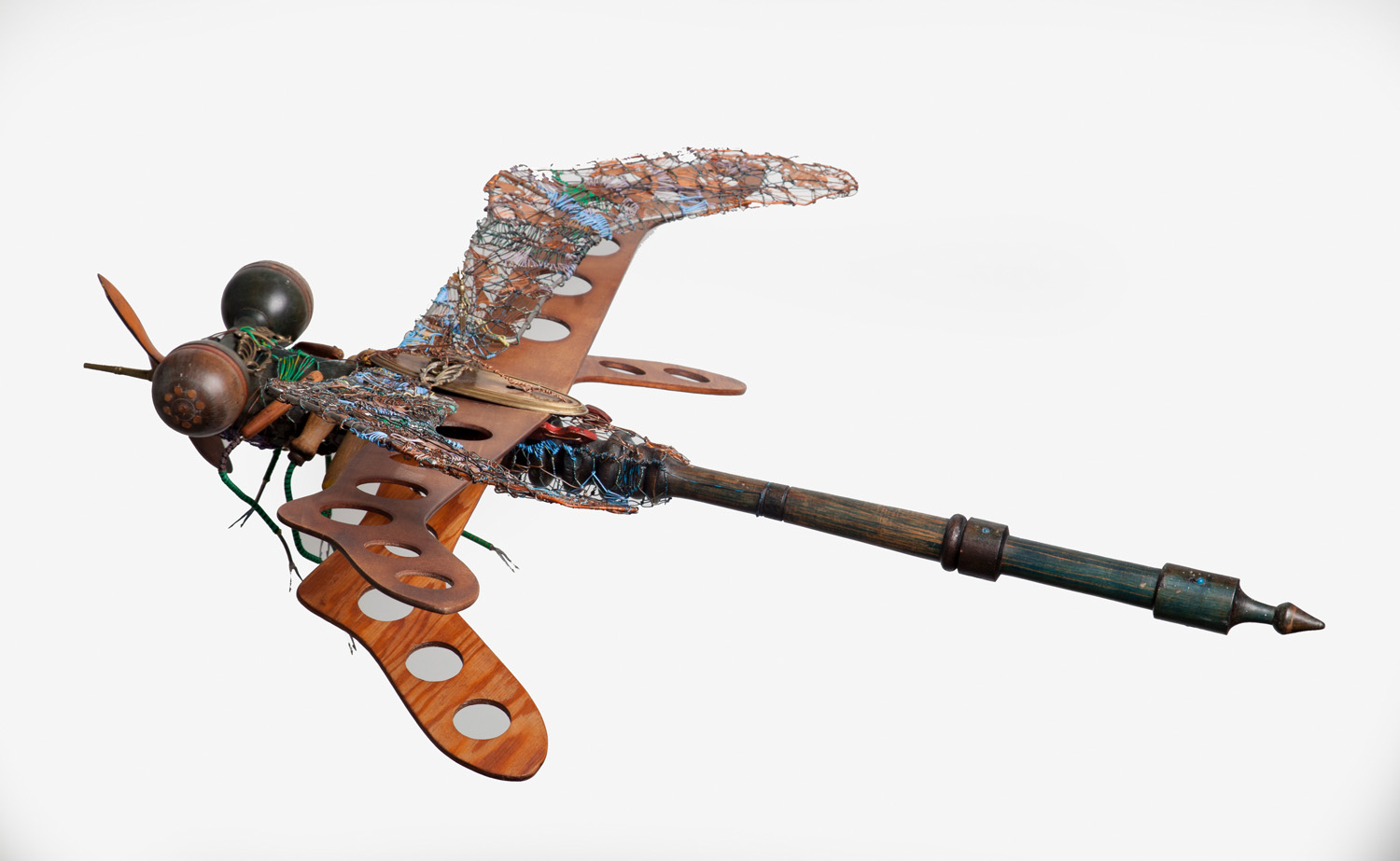 "Fay Wood at Emerge Gallery, ""Dragonfly,"" mixed media including found metal and a model plane propeller, 44"" x 40"" (date?)"