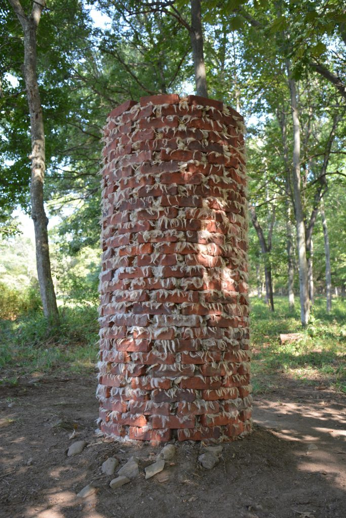 "Alison McNulty, ""Untitled (Hudson Valley Ghost Column 1),"" 2017, Historic Hudson Valley-​​made Lahey bricks salvaged from Newburgh and unprocessed Cormo sheep wool sourced from New Paltz fiber farm, courtesy the artist"