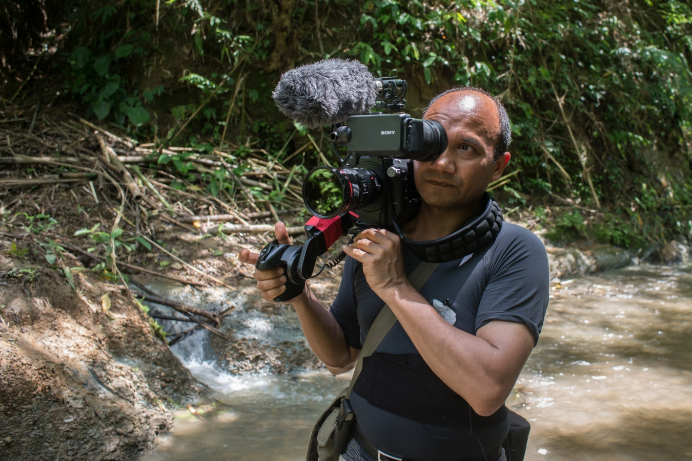 Director and cinematographer SHAHEEN DILL-RIAZ films the loggers in the forest. Photographer / © : Munem Wasif